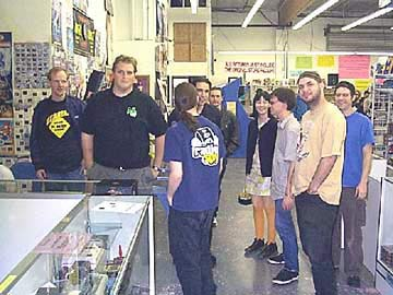 A group shot at Gamedude, one of the more select game shops in all of So-Cal. L to R: Mitch O., Geoff V., William C. (back toward us) Adam T., Jason W., Aileen H., Christopher B., John A., and Jeff.