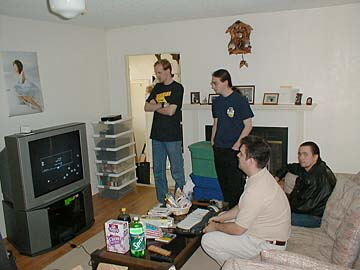 One of life's beautiful moments is seeing MAME run on HDTV. Mitch O., William C., Rob W., and Jason W. watch the wonder of Omega Race on a screen larger than a cocktail cabinet.