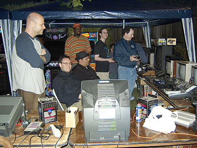 Guests laugh along with Rob W. during a spicy game of Rock, Paper, Scissors on the Saturn