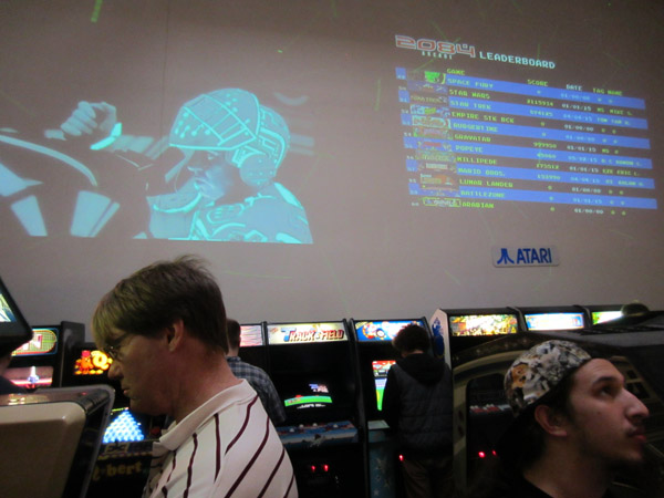 2084 uses a projector to track high scores, and another to project Tron, the highest-scoring movie among arcade goers