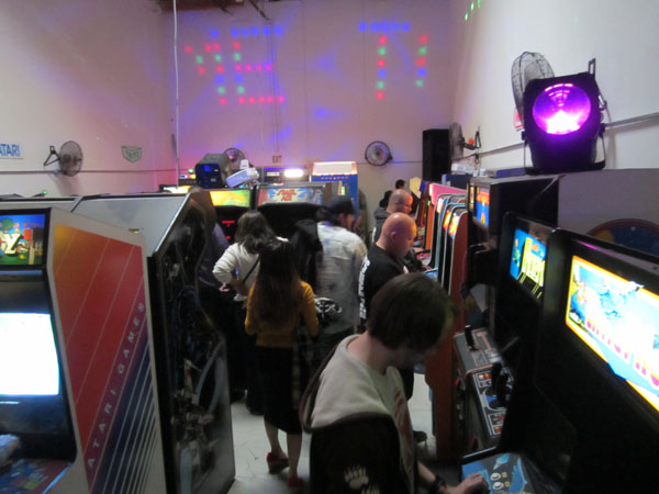 2084 Arcade's lower floor is jam-packed with classic coin-ops, signs and cool neon-hued lighting effects
